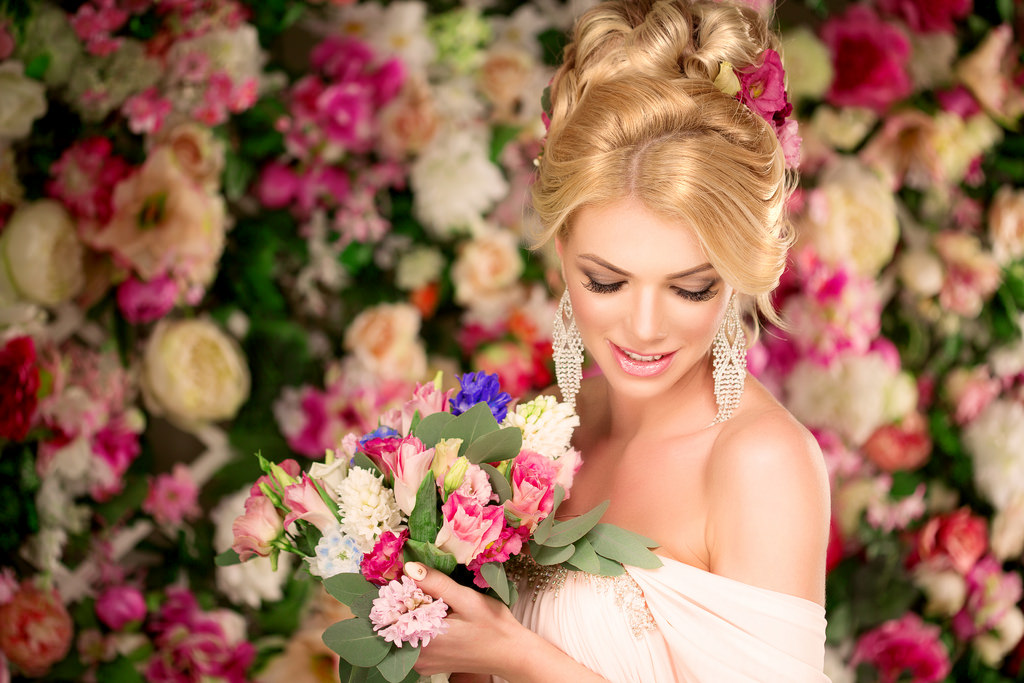 Woman with fancy updo with flowers all around